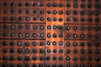 Close_up of a metal panel with rivets
