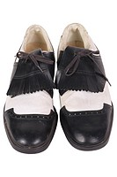 Black and white golf cleats uid 1197060