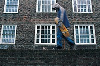 Teenager walking past a building (thumbnail)