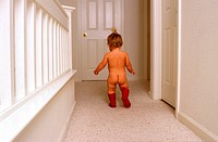 little baby walking nude in corridor