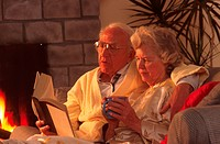 elderly couple reading together