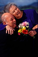 elderly couple hugging