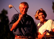 elderly couple at the golf course
