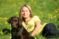 young woman and young Labrador Retriever dog