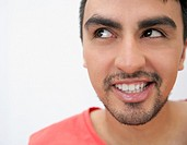 Grinning Hispanic man