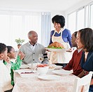 African American family about to enjoy Thanksgiving dinner