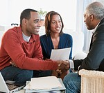 African American couple talking with financial advisor