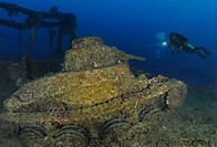 Scuba diver views Japanese battle tank on shipwreck San Francisco Maru, Maru, Chuuk, Micronesia, Pacific