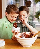 Two boys making chocolate soufflé together