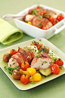 Stuffed, bacon_wrapped chicken breast with tomatoes and courgettes