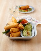 Meat_filled spring rolls with cucumber and spicy sauce