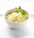 Couscous in bowl with mint