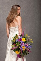 bride holding extravagent bouquet, studio shot