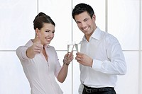 Business woman and business man toasting with sparkling wine