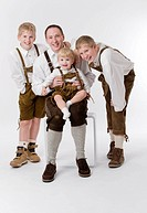 father and sons in lederhosen