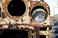 detail shot of extremely rusty, yellow tractor