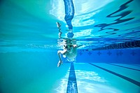 boy swimming laps, shot underwater