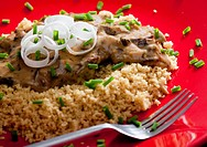 beef meat with mushroom sauce on couscous