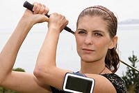 woman golfing with an iphone