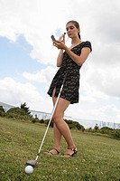 woman applying makeup while golfing