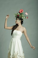 Beautiful fashion model posing with flowers in hair