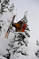 A young man doing a front flip in the Revelstoke Backcountry, BC