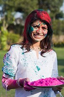 Woman holding a plate of gulal on Holi