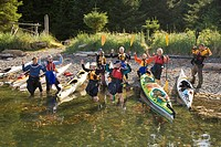 A group of senior women celebrates their day of paddling at West Coast Expeditions on Spring Island. Kyuquot Sound, Northern Vancouver Island, British...