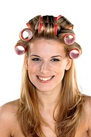 beautiful girl with hair curlers