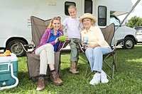Mother daughter and grand daughter sit outside RV home