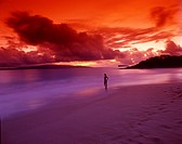 Young woman on a deserted beach on sunset  Makena beach, Hawaii, Maui, USA