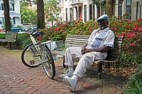 African American man relaxing in Whitfield Square in Savannah GA