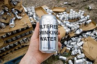 Cans of water were given out for free in the Lower Ninth Ward section of New Orleans, 9 months after Hurricane Katrina