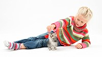 Five_year_old girl with silver tabby kitten.