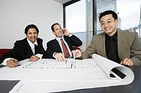 Portrait of businesspeople smiling in an office