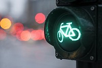 Close-up of traffic light for bicyclists, showing green light at an intersection with blurred background, Hamburg, Germany, Europe