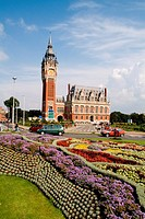 Colorful flowers and the beautiful Hotel de Ville Town Hall in Calais, France.
