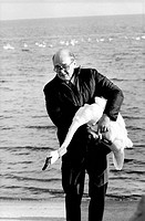 Sir Peter Scott September 14, 1909 _ August 29, 1989, British ornithologist, with Banded Whistling Swan. Chesapeake Bay.