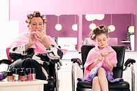 grandmother and young girl together at hair salon