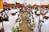 groups of dancers and musicans are celebrating a ritual in front of the priests with the tabot  Timkat ceremony of the ethiopian orthodox church in Ad...