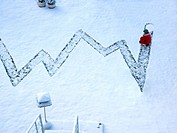 high angle view of child and chart drawn into the snow