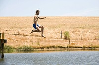 Man jumping into lake