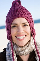 Woman wearing a knit hat and scarf