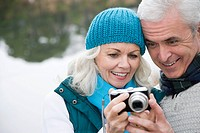 Mature couple with camera