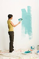 Woman choosing paint color (thumbnail)