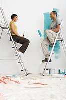 Couple sitting on stepladders