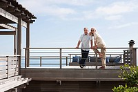 Mature couple at beach house