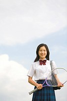 High school girl holding tennis racket