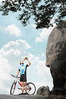 Male cyclist drinking water