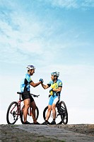 Male cyclists shaking hands